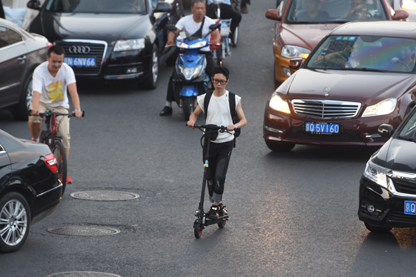 Scooters banned from roads in Beijing, Shanghai